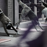 Washed out image of various women practicing yoga