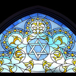 Stained glass inside of a synagogue featuring the Star of David