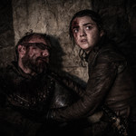 two bloodied people sit on the ground in Game of Thrones