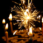 Closeup of candles and a sparkler on a birthday cake