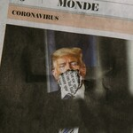 A newspaper showing Donald Trump with his face cut out.