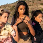 Sabina (Kristen Stewart), Jane (Ella Balinkska), and Elena (Naomi Scott) stand in the middle of an empty road in fighting poses.