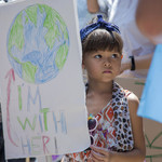 a child in Bangkok supports the climate strike social.
