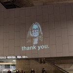 "A projection of Dr. Christine Blasey Ford's face on the San Francisco Federal Building, with the words ""thank you"""