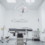 An immaculately clean, white hospital room