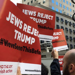 "Bend the Arc activists protest with red signs that say ""Jews Reject Trump #WeveSeenThisBefore"" in June 2016"