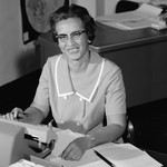 Katherine Johnson sitting at work desk