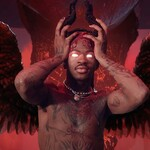 Lil Nas X, a young Black man, places the devil's horns on his head and stands in hell, which is red and rocky.