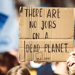 """A sign reading, """"There are no jobs on a dead planet."""""""
