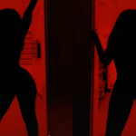 a thin, Black woman poses naked behind a red filter for the TikTok Silhouette Challenge
