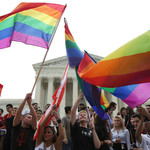 People celebrate in front of the Supreme Court after the ruling in favor of same-sex marriage on June 26, 2015 in Washington, D.C.