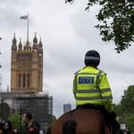 Police ride horses in London.