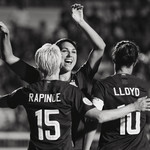 Megan Rapinoe, Alex Morgan and Carli Lloyd embrace cheerfully