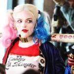 Harley Quinn in the film Suicide Squad has pink and blue pigtails and a big baseball bat.