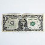 A U.S. $1 bill against a white background