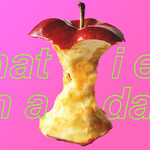 "An apple with the text, ""what I eat in a day."""