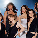 Nine women, the cast of the popular television show The L Word, pose dramatically for a promotional photo.