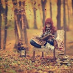 stock photo of girl reading outside in autumn