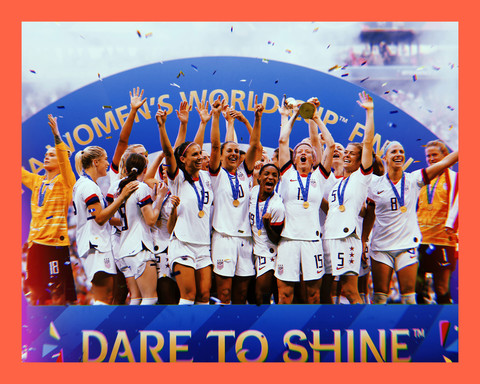 group photo of the U.S. Women's National Soccer Team with their hands in the air, celebraiting their World Cup win