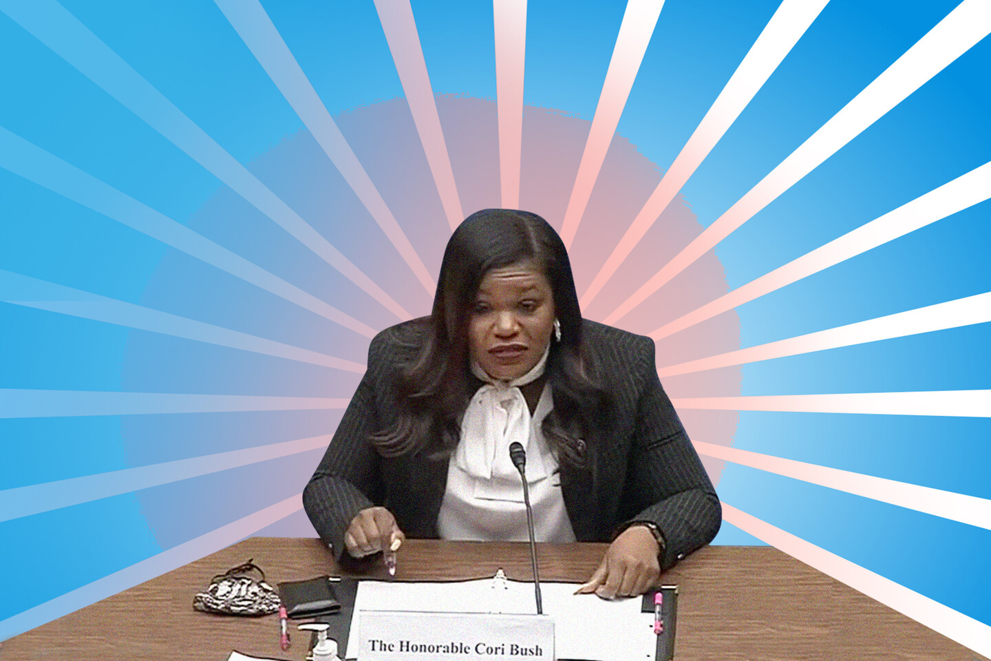 an illustration of Cori Bush, a brownskinned Black woman with long, black hair, sitting at a desk and surrounded by light blue rays