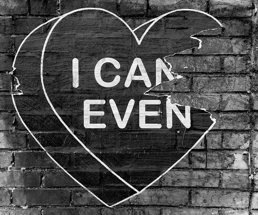 Image is a heart on a brick wall with Can't Even written in it.