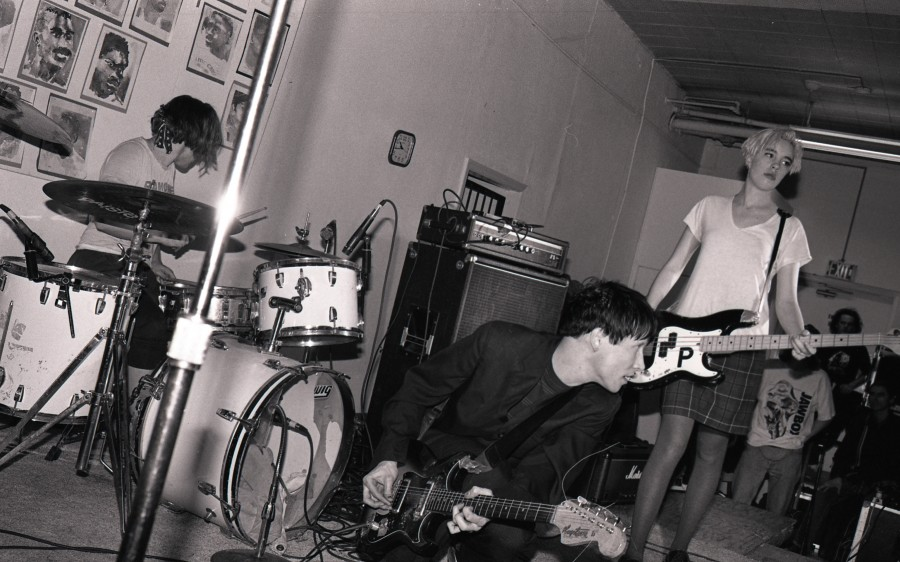 Kathi Wilcox and other members of Bikini Kill playing a show