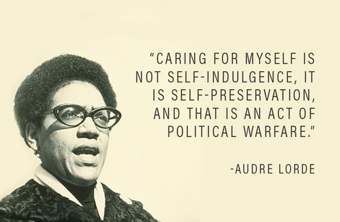 black-and-white stencil of Audre Lorde speaking, with quote above in black text