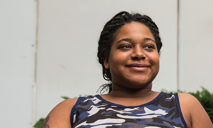 Erica Garner seated and smiling off camera to the right