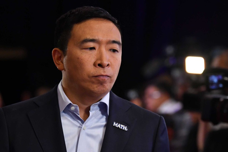 Andrew Yang, an Asian American former presidential candidate, speaks on stage.