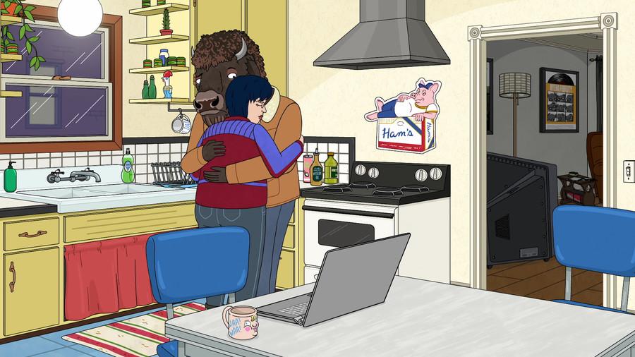 Diane Nguyen, a Vietnamese American, hugs her boyfriend, Guy, a bison man, in their kitchen.