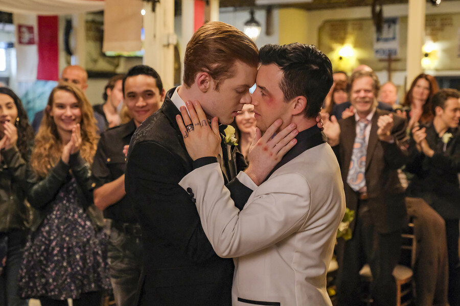 Ian and Mickey, a same-sex couple on Shameless, embrace during their wedding