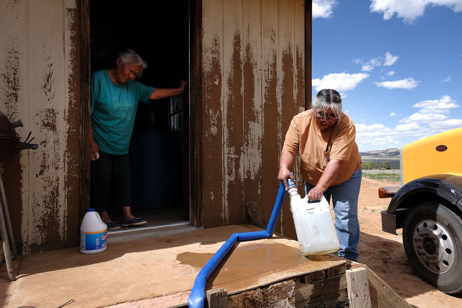 Nancy Bitsue, a member of the Navajo Nation, receives her monthly water delivery