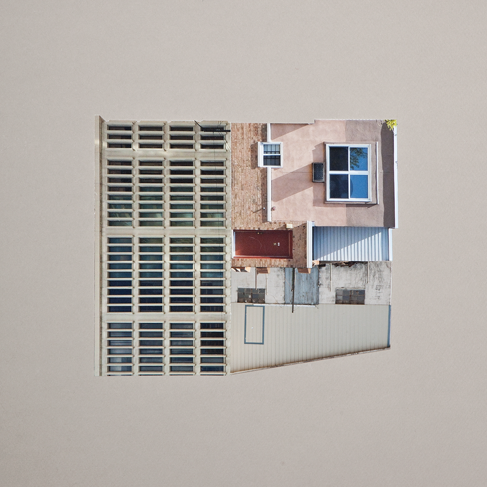 An image of a white and blue house illustrated by Krista Svalbonas