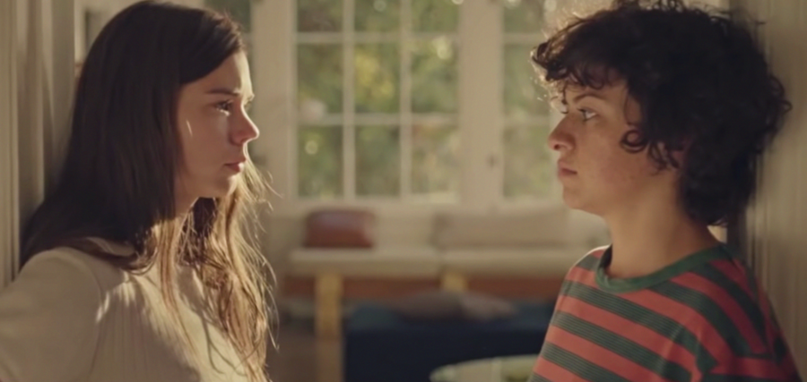 Duck Butter's Sergio (Laia Costa) and Naima (Alia Shawkat), two women, who stand across from each other. One has long brown hair and is very pale, the other is pale with freckles and short, dark curly hair.