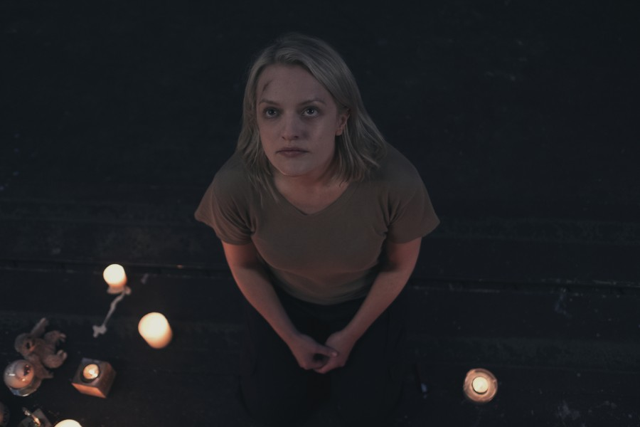 Elisabeth Moss as Offred/June in The Handmaid's Tale