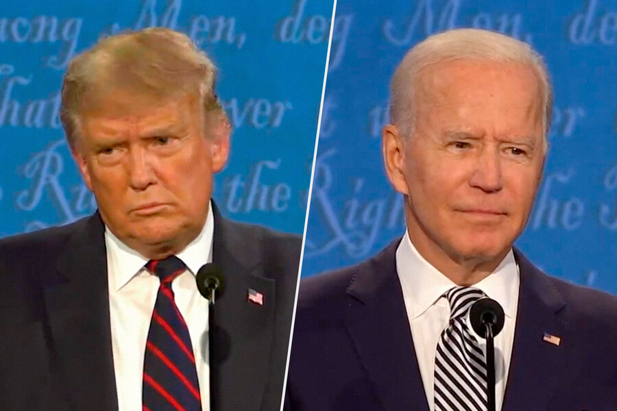 President Donald Trump and former Vice President Joe Biden stand on stage.
