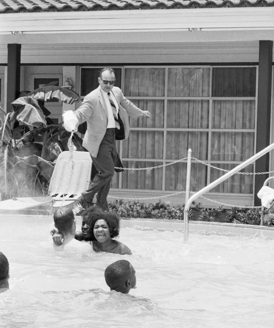 Motel manager pouring bleach on Black people in a pool