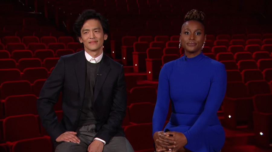 John Cho and Issa Rae, an Asian man and a Black woman, respectively, sit next to each other at the Oscars.