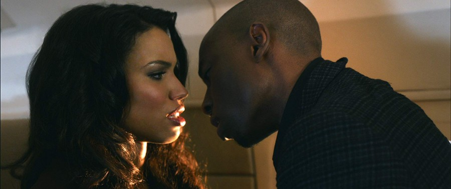Jurnee Smollett-Bell as Judith and Robbie Jones as Harley facing each other in Temptation: Confessions of a Marriage Counselor