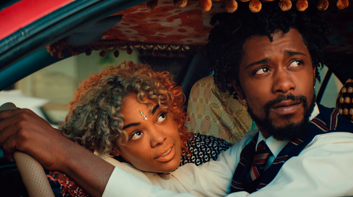 Tessa Thompson with Lakeith Stanfield, both looking out a car window