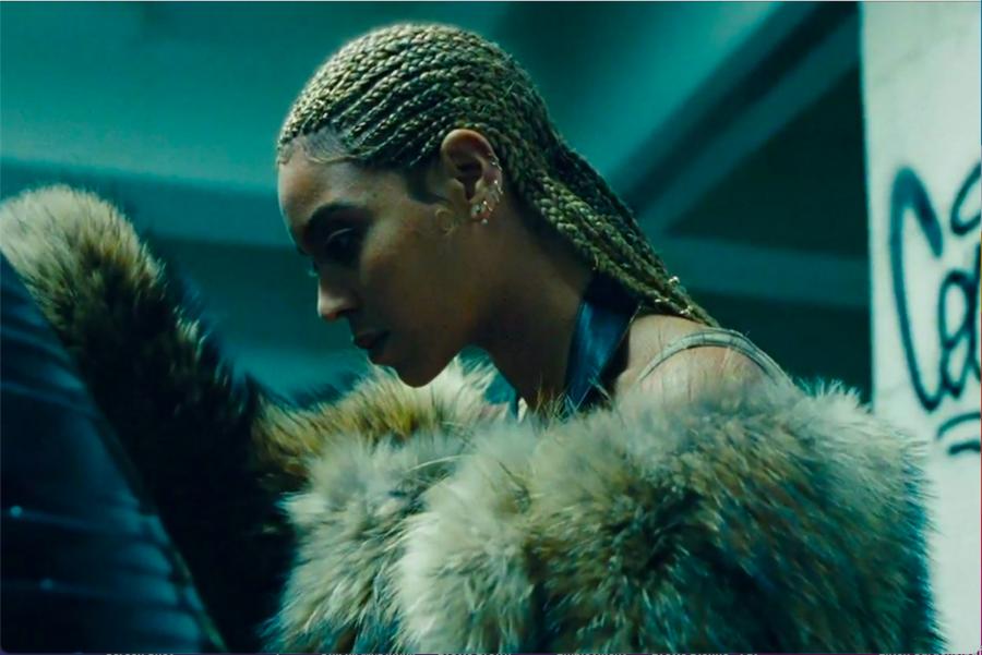 Beyoncé, a light-skinned Black woman wearing cornrows, poses in profile in the visual album for Lemonade