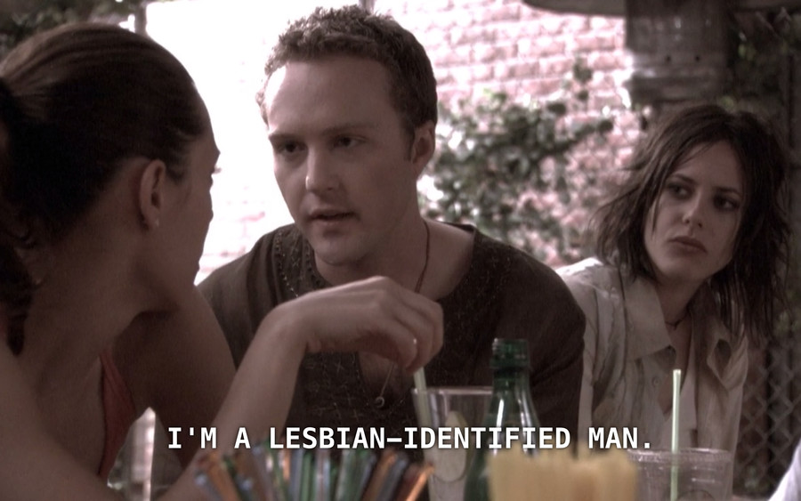 A photo of Lisa, a white person, in Season 1 of The L Word.