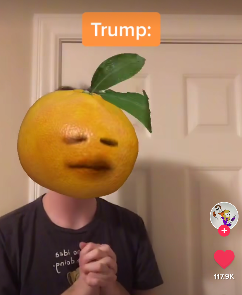 A TikTok video from user @iterc, which shows them with an orange filter over their face. They have the word