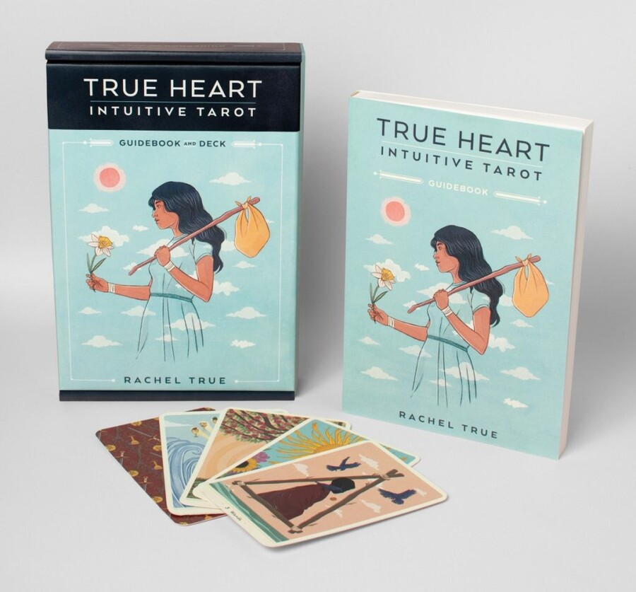 True Heart Intuitive Tarot is a light blue book that features an illustration of a Black woman holding a yellow knapsack over her shoulder