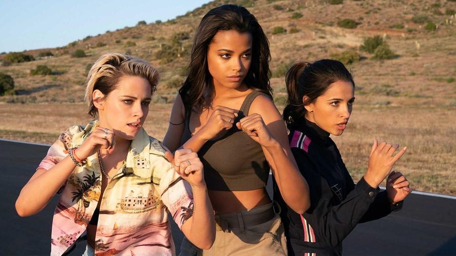 Sabina (Kristen Stewart),Jane (Ella Balinkska), and Elena (Naomi Scott) stand in the middle of an empty road in fighting poses.