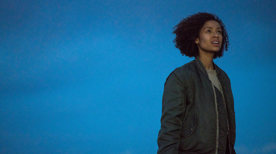 Ruth (Gugu Mbatha-Raw) in Fast Color stands in front of an empty sky