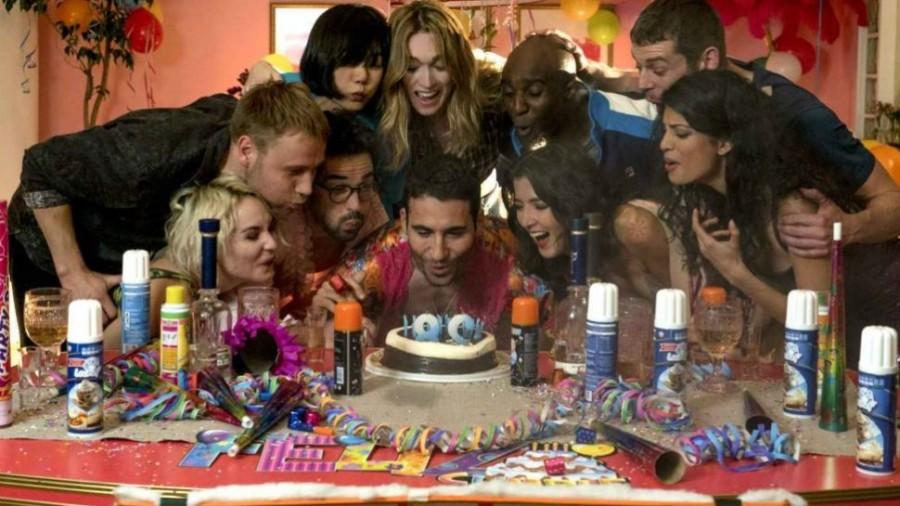 the sensates huddle festively around a birthday cake