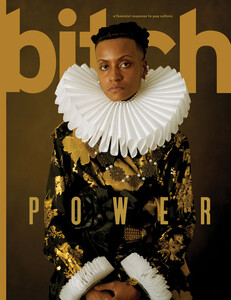 The Power issue cover featuring Meech, a Black woman with short hair dressed in a black and gold embroidered jacket and a Shakespearean ruff adorned around her neck, arms crossed in front giving a commanding look and demeanor.