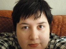 Diane Shipley, a white woman with short, black hair, takes a selfie