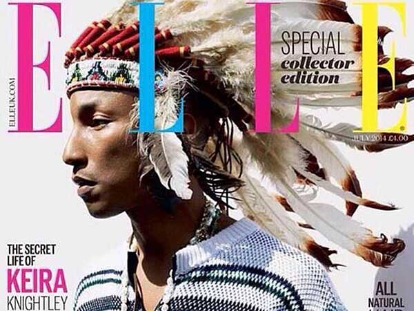pharrell, wearing a headdress on the cover of the UK Elle